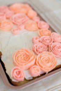 buttercream roses piped on sheet cake