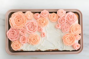 sheet cake in rose gold pan with buttercream roses