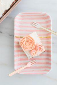 Buttercream roses on striped cake plate