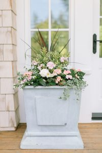 large planter box with soft pink flowers