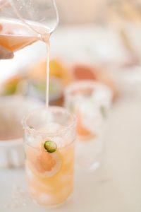 pouring grapefruit juice in margarita