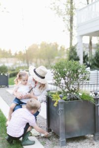 mom in garden with kids