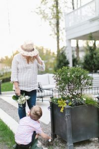 mom and son planting in garden