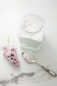 suga jar with lilac and spoon