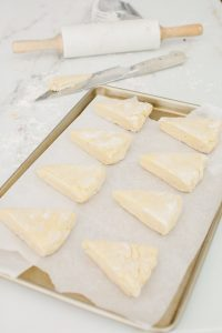 scones being places on baking sheet