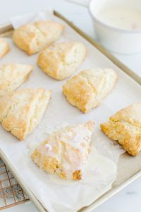 scones on baking sheet, white chocolate drizzle