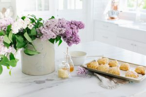 scones on counter with lilacs in crock