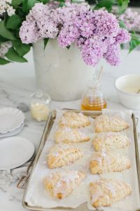 scones with white chocolate drizzle and lilacs