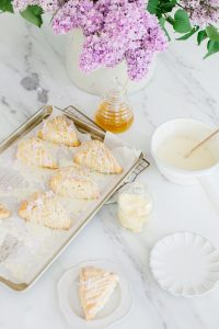 lilac scones on tray with drizzled icing