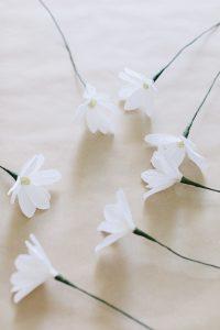 crepe paper daisy on kraft paper