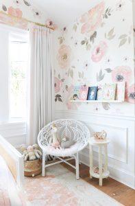 floral wallpaper, white rattan chair