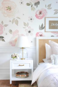 floral wall paper, lamp and nightstand
