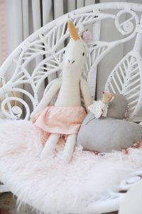 unicorn stuffed animal on chair