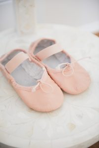 little girl pink ballet slippers