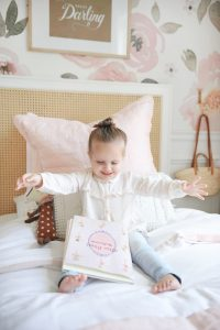 little girl happy on bed