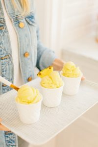 girl holding tray of pineapple sorbet