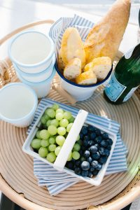 grapes and bread on tray