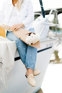 feet over the edge of sailboat
