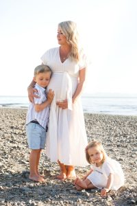 mom on beach pregnant white dress, with kids