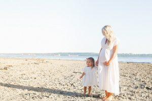 girl and mom on beach