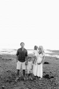 family photo on rocky beach