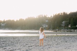 little girl pointing on beach