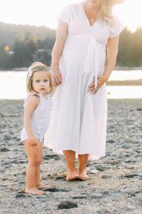 mom on beach with little girl
