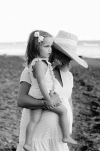 mom on beach little girl