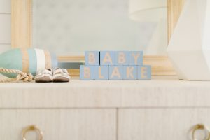 baby blake in block letters on grasscloth dresser