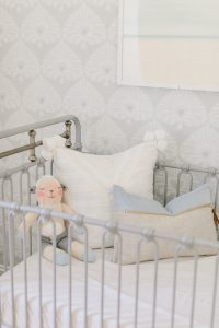 grey metal crib in nursery
