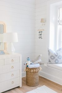 boys coastal nursery with window seat and shiplap