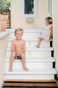 little boy on white steps
