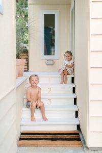 kids sitting on back porch steps in summer