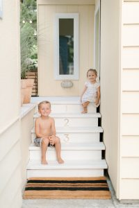 kids on back porch steps in summer