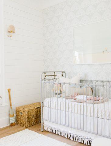 coastal nursery with shiplap and window seat