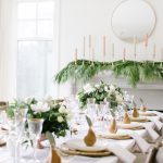 table setting with golden pears, garlands, pink and white candles