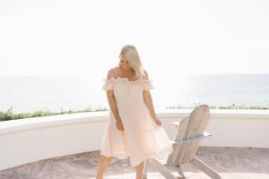 woman in ruffle detail pink linen dress