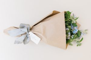 bouquet of soft blue flowers wrapped