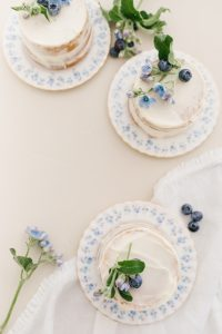 3 mini vanilla cakes with flowers and blueberries