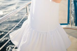 hem detail on white drop waist dress