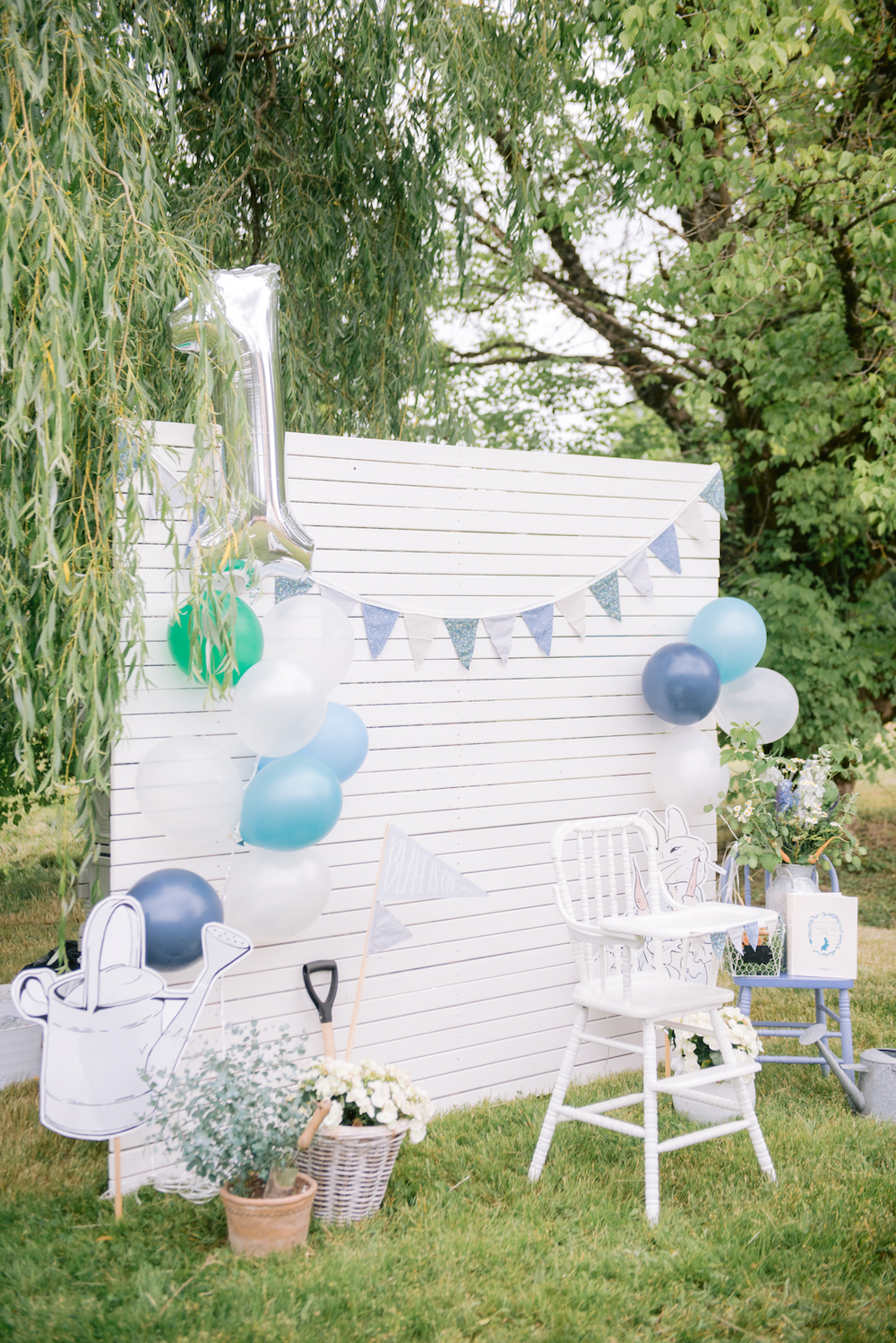 photo backdrop with peter rabbit themed props