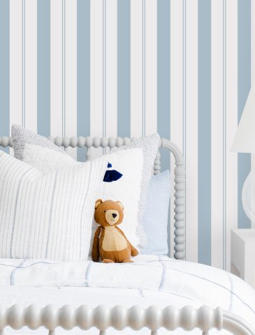 Little Boys Bedroom with Teddy Bear on the Bed and the #MHxUrbanWalls Wallpaper in Brighton Stripes in Blue