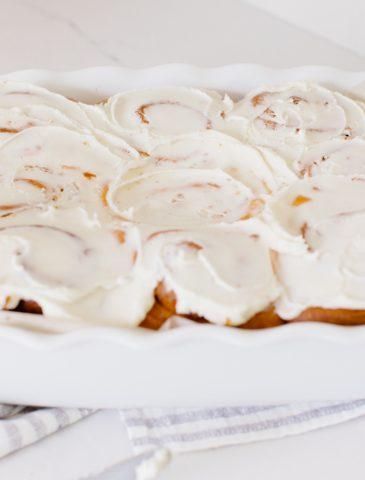 iced Cinnamon Buns in a porcelain baker